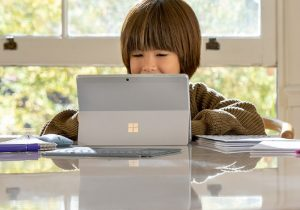 kid using microsoft go 2 at kitchen table